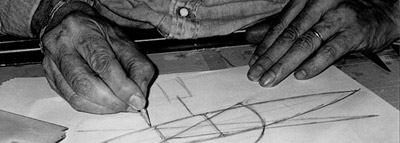Joan Pedragosa drawing a sketch on his work table.